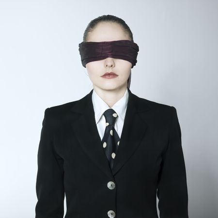 studio shot portrait of a beautiful young blindfold woman in a costume suit Stock Photo - 2966745