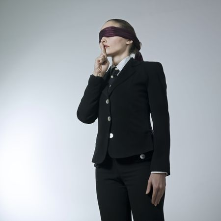 studio shot portrait of a beautiful young blindfold woman in a costume suit  Stock Photo - 2966640