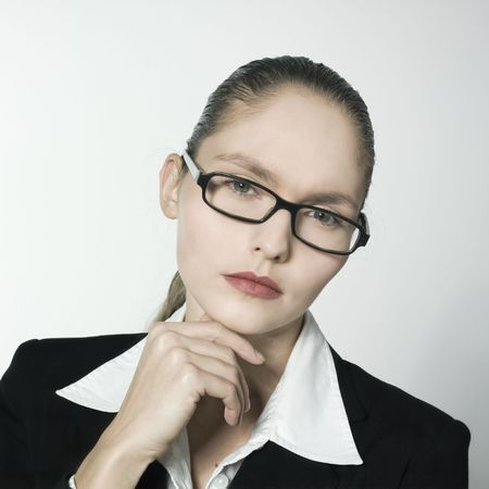 studio shot portrait of a beautiful young and strict woman in a costume suit  Stock Photo - 2966654