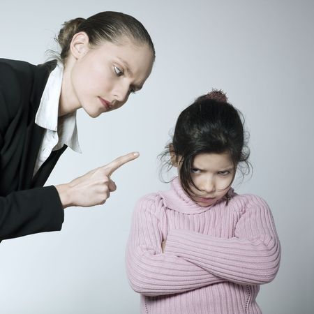 studio shot of a young woman having problem educate her child Stock Photo - 2966749