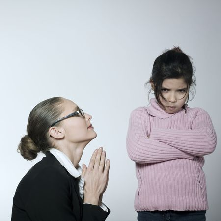 studio shot of a young woman having problem educate her child  Stock Photo