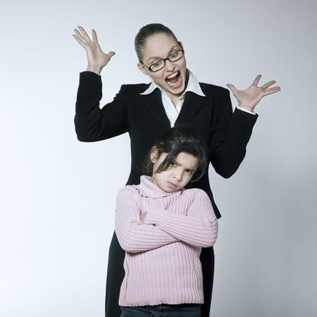 angry teacher: studio shot of a young woman having problem educate her child  LANG_EVOIMAGES