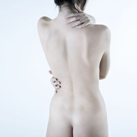 naked woman back: studio shot picture of the back young beautiful naked caucasian woman lying on a white floo