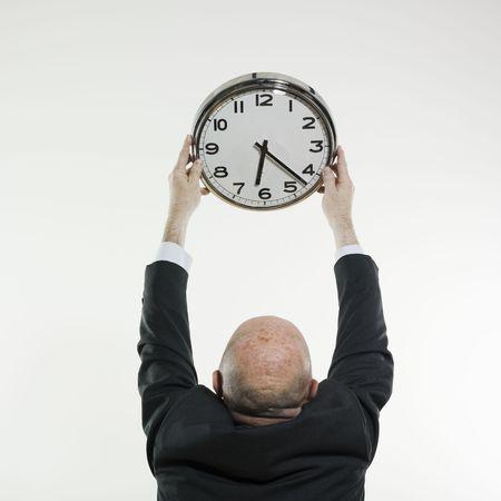 studio portrait isolated on white background of a man senior back holding a clock Stock Photo - 2966789