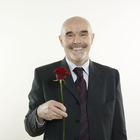 studio portrait isolated on white background of a man senior holding a rose flowe Stock Photo - 2966790