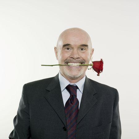 studio portrait isolated on white background of a man senior holding a rose flowe Stock Photo - 2966791