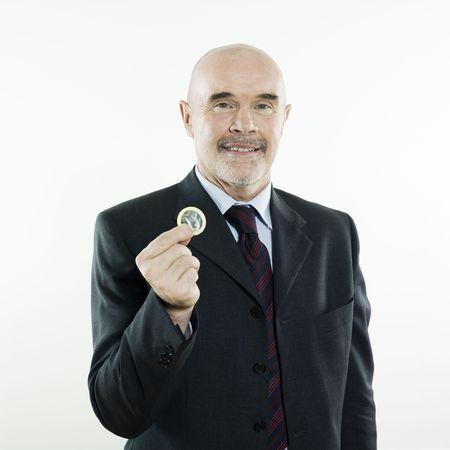 studio portrait isolated on white background of a man senior holding a condom Stock Photo - 3084008