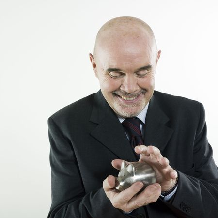 studio portrait isolated on white background of a man senior hoding a piggy bank Stock Photo - 3084010
