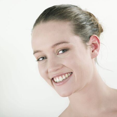chignon: studio natural beauty portrait on isolated background of a young beautiful caucasian woman