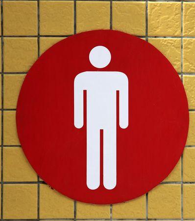 men restroom signal on the yellow ceramic background  Banco de Imagens