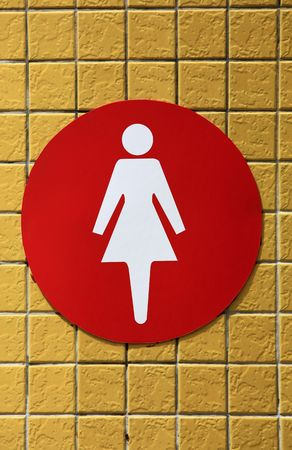 women restroom signal on the yellow ceramic background  Banco de Imagens