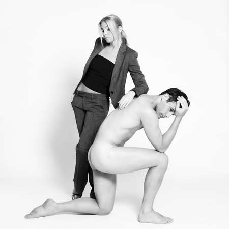studio shot on isolated background of a beautiful heteroual couple with the man naked Stock Photo - 3540466