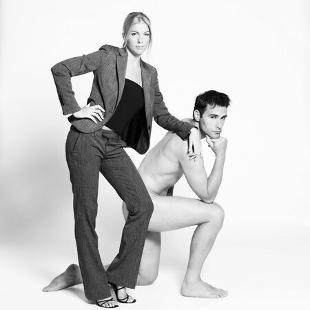 studio shot on isolated background of a beautiful heteroual couple with the man naked Stock Photo - 3540529