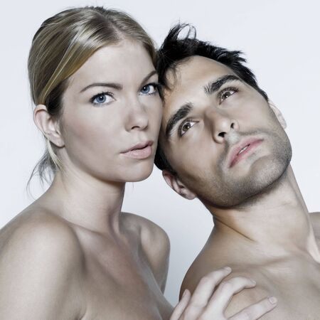studio shot on isolated background of a beautiful heterosexual couple with the man naked Stock Photo - 3540457