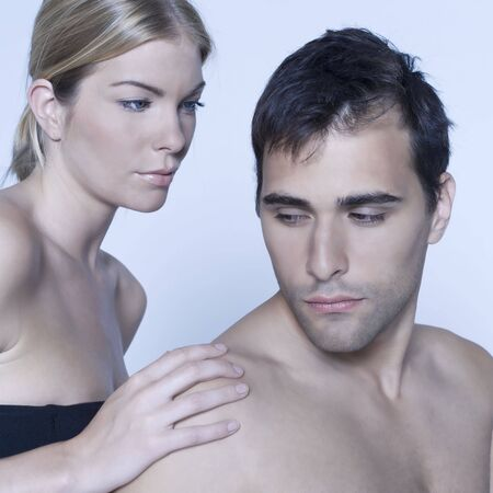 studio shot on isolated background of a beautiful heterosexual couple with the man naked Stock Photo - 3540488