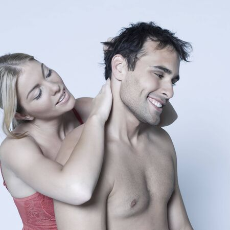 studio shot on isolated background of a beautiful heterosexual couple with the man naked Stock Photo - 3540485