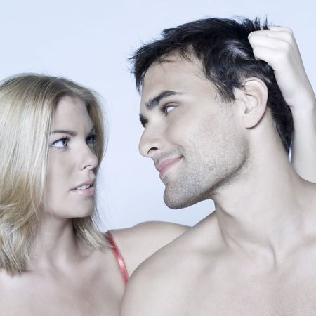studio shot on isolated background of a beautiful heterosexual couple with the man naked Stock Photo - 3540484