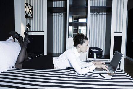 beautiful caucasian woman in a hotel bedroom Stock Photo - 3641245