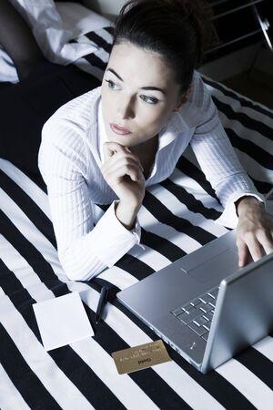 beautiful caucasian woman in a hotel bedroom Stock Photo - 3641243
