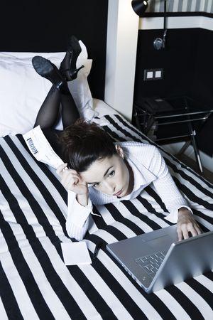 beautiful caucasian woman in a hotel bedroo Stock Photo - 3641240