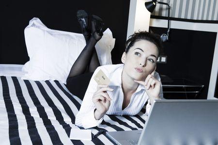 beautiful caucasian woman in a hotel bedroom Stock Photo - 3641238