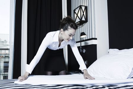 beautiful caucasian woman in a hotel bedroom Stock Photo - 3641597