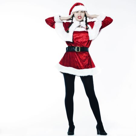 young funny and expressive woman dressed as santa claus is doing her shopping Stock Photo