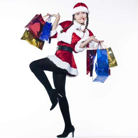 annoyed girl: young funny and expressive woman dressed as santa claus is doing her shopping LANG_EVOIMAGES