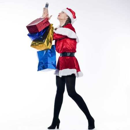 bore: young funny and expressive woman dressed as santa claus is doing her shopping