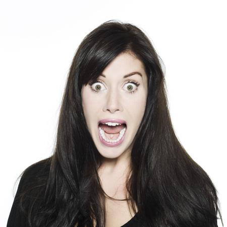 isol� sur fond blanc: studio shot portrait isol� sur fond blanc d'un Beautiful Woman Funny expressive
