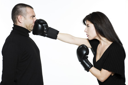 domination: studio shot portrait on isolated white background of a Beautiful Funny couple expressive fighting LANG_EVOIMAGES