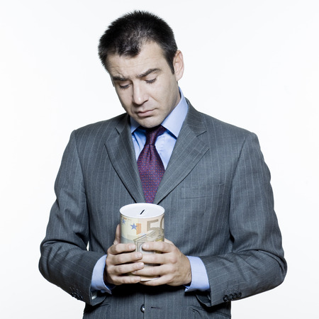 displeased businessman: expressive portraits on isolated white background of a handsome  businessman on stock market crisis