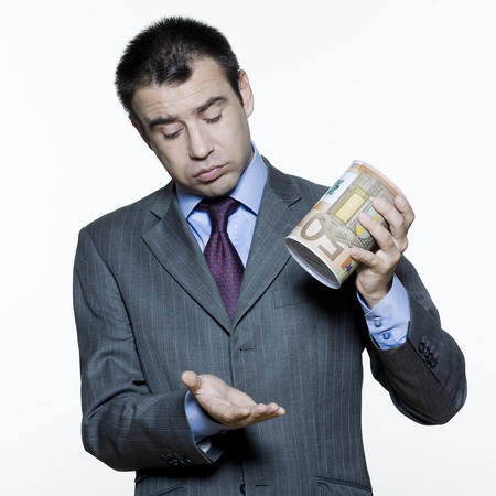 expressive portraits on isolated white background of a handsome  businessman on stock market crisis Stock Photo - 4006810
