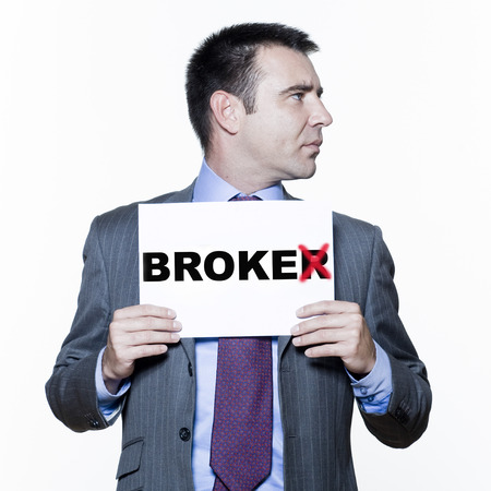 broke: expressive portraits on isolated white background of a handsome  businessman on stock market crisis