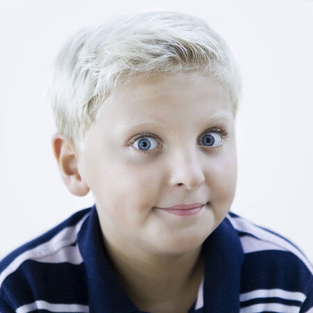 sympathetic: portrait of a smart caucasian expressive kid on idoor isolated background LANG_EVOIMAGES