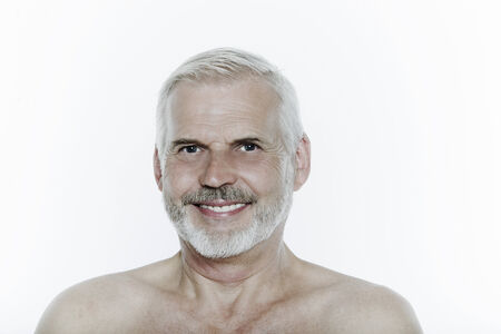 expressive portrait of a handsome senior man on isolated background Stock Photo - 3999428