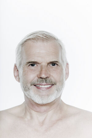 expressive portrait of a handsome senior man on isolated background Stock Photo - 3999559