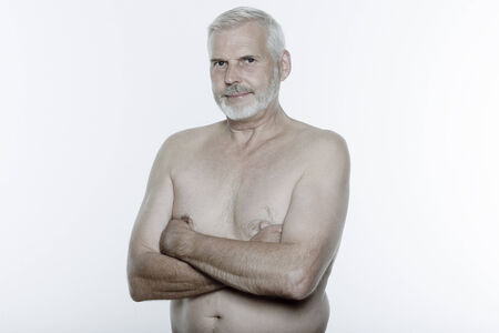 expressive portrait of a handsome senior man on isolated background
