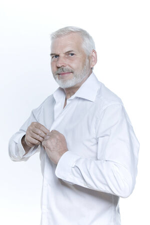 expressive portrait of a handsome senior man on isolated background Stock Photo - 3999368