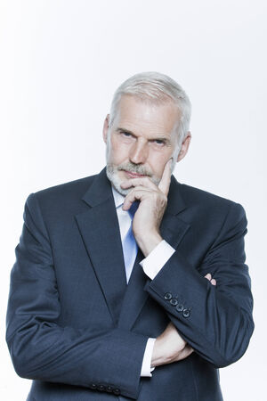 expressive portrait of a handsome senior businessman on isolated background Stock Photo - 4006772