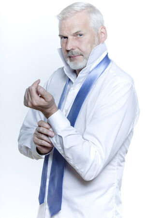 windsor necktie lesson doing by an handsome man Stock Photo - 3999460