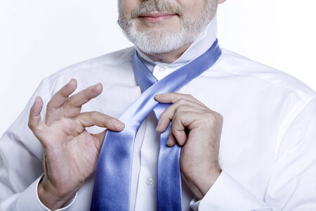 windsor necktie lesson doing by an handsome man Stock Photo - 3975618