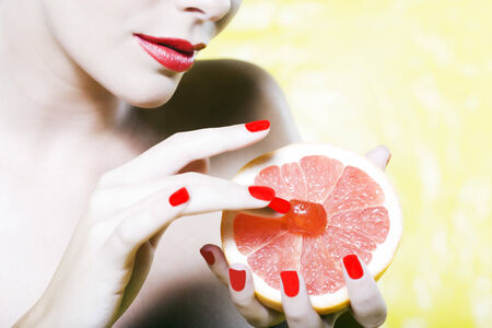 beautiful woman portrait with colorful make-up  and background holding grapefruit Stock Photo - 3975582