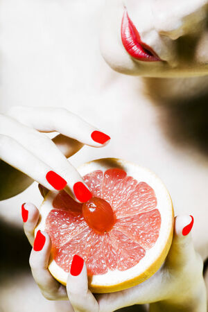beautiful woman portrait with colorful make-up  and background holding grapefruit Stock Photo - 3975595