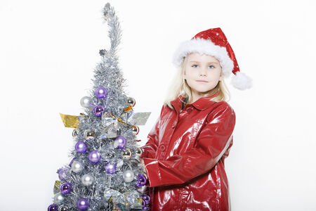 indoors picture of a little girl preparing christmas tree on isolated white background Stock Photo - 3999598