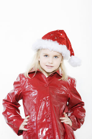 indoors picture of a little girl preparing christmas tree on isolated white background Stock Photo - 4006792