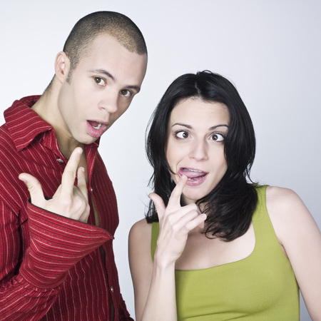 fool: young couple grimacing on isolated background