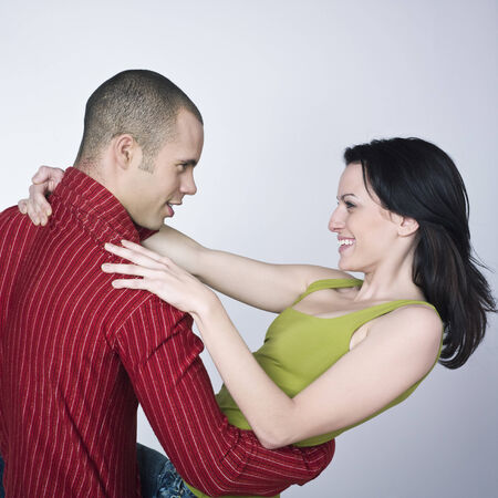 young loving couple on isolated background Stock Photo - 3999772
