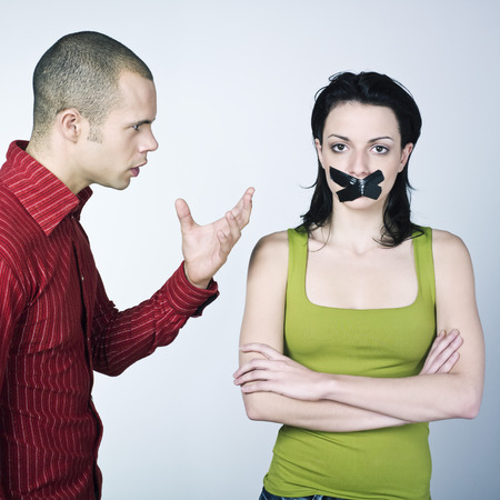 stifle: young couple conflict on isolated background