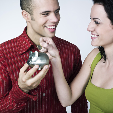 young couple saving on isolated background Stock Photo - 3999770